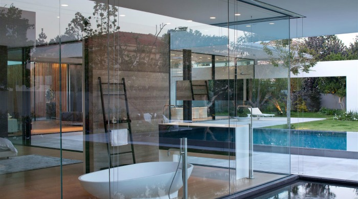 A view of a bathroom through the glass walls of the Float House.