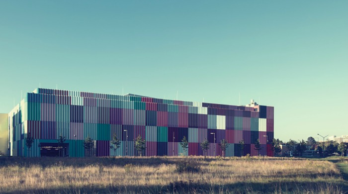 The colourful Mira shopping center by Nick Frank.