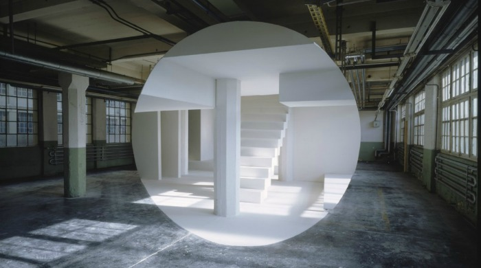 A large white circle in the middle of an industrial room by Georges Rousse.