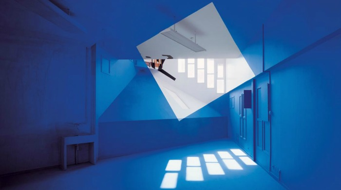 A large white square painted on a blue room by Georges Rousse.