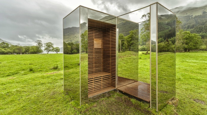 The mirrored viewpoint in a large field surrounded by mountains.