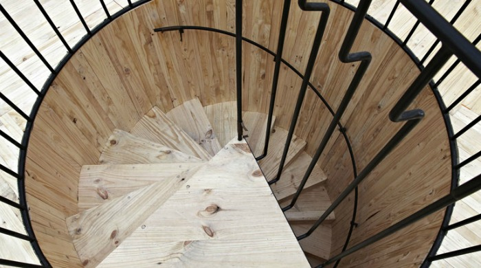 A wooden spiral staircase at the Royal Academy of the Arts.