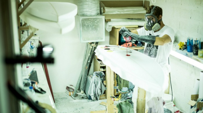 A bespoke surfboard being painted by Blank Surfshack.