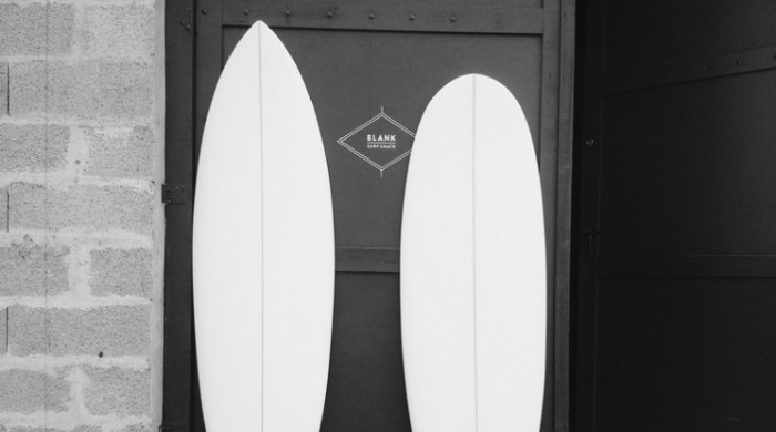 Two white finished surfboards by Blank Surfshack.