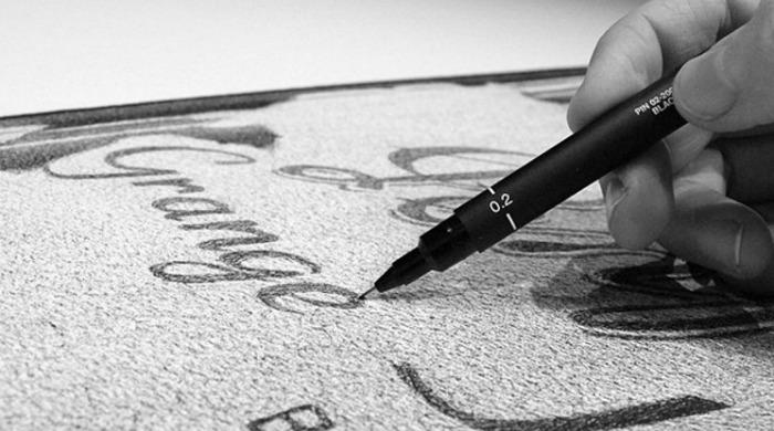 CJ Hendry working on a pen drawing.