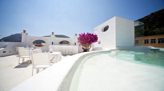 The pool and outdoor seating area at the La Settima Luna Hotel, Lipari.