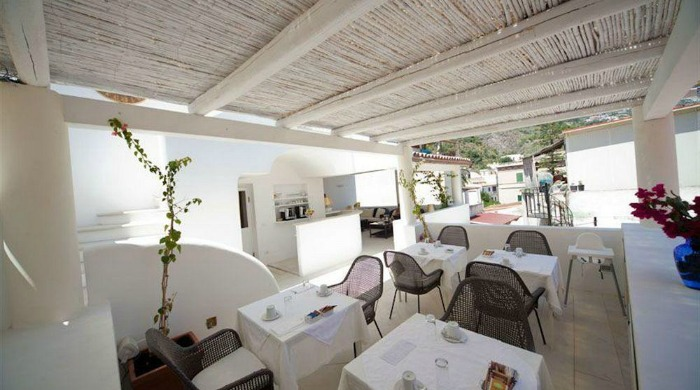 A covered outdoor dining area at the La Settima Luna Hotel, Lipari.