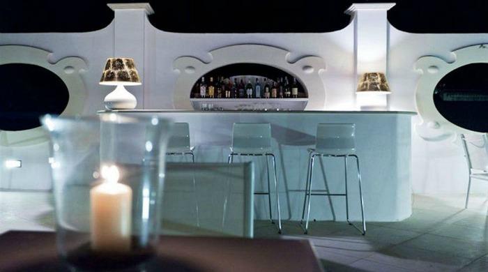 The outdoor bar lit up at night at the La Settima Luna Hotel, Lipari.