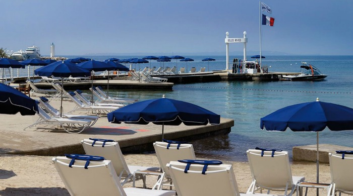 The beach area and sunloungers at the Hotel Belles Rives.