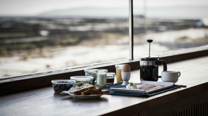 A breakfast tray on a windowsill.