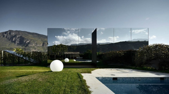 A view of the Mirror Houses in South Tyrol from the pool and garden.