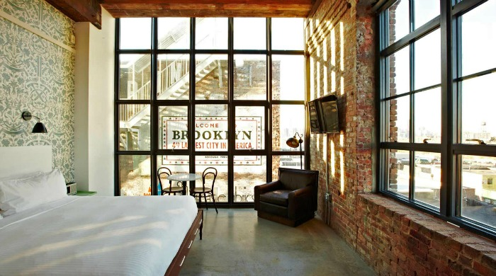 A room in the Wythe Hotel, Brooklyn with large grid windows.