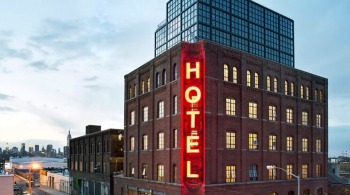 "The large, red neon ""HOTEL"" sign on the Wythe Hotel, Brooklyn."