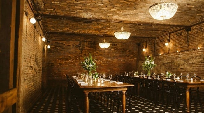 A dining area with brick walls and ceiling at the Wythe Hotel, Brooklyn.