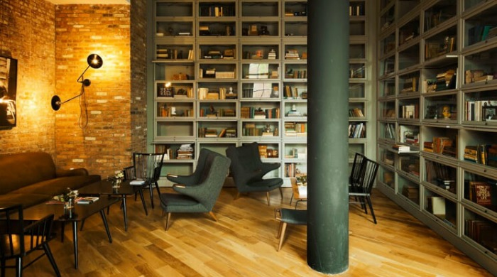 A library with brick walls in the Wythe Hotel, Brooklyn.