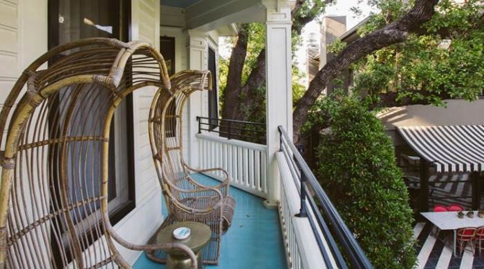 A porch with outdoor seating at the Hotel Saint Cecilia, Austin.