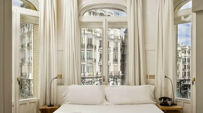 A white bedroom with view over the city in the Praktik Metropol, Madrid.