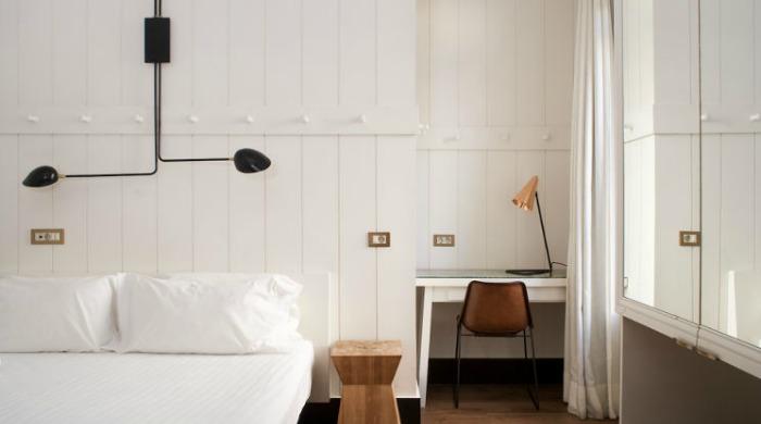 A white bedroom in the Praktik Metropol, Madrid.