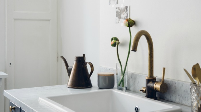 The kitchen sink of a modern Swedish apartment.