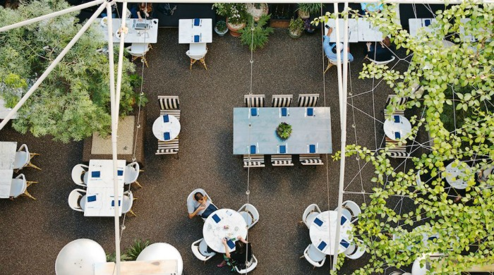 An outside dining area in Palihouse West Hollywood.