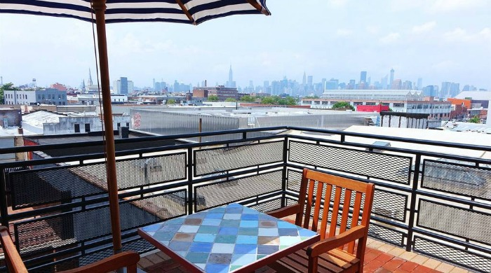 A terrace with views over the city at the Henry Norman Hotel, Brooklyn.