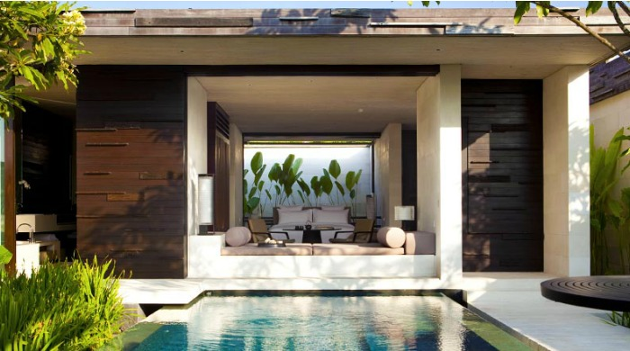 A view into a room from a pool at Alila Villas Uluwatu, Bali.