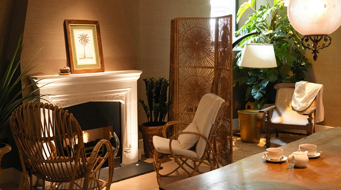A seating area with a fireplace in The South Kensington Club.