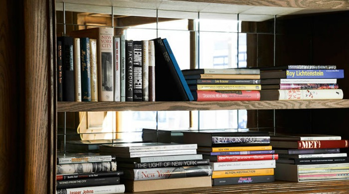 A close up of a bookshelf in The Marlton, NYC.