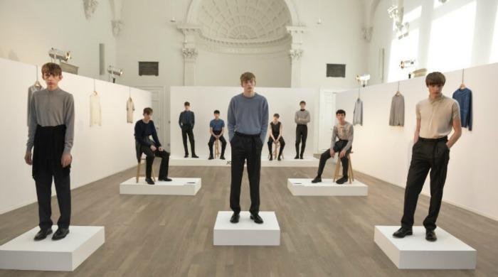 Male models posing in John Smedley knitwear.
