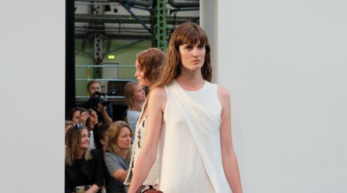 A model on the runway wearing By Malene Birger SS16.