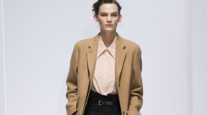 A model at London Fashion Week AW16 wearing a camel coat.
