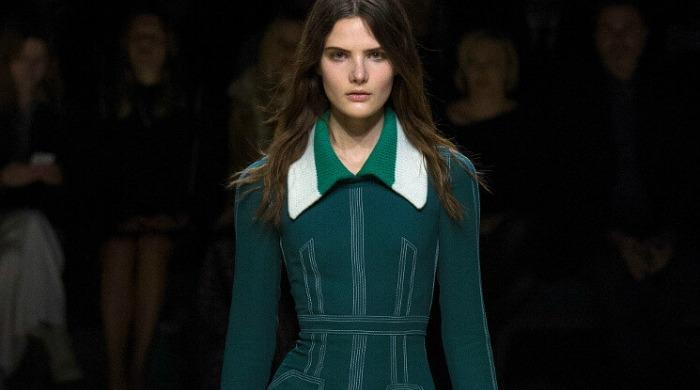 A model at London Fashion Week AW16 wearing a green coat.
