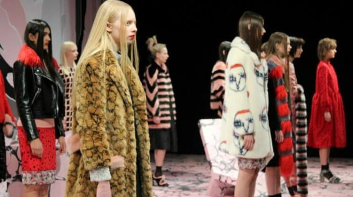 Models at London Fashion Week AW16 wearing faux fur coats.