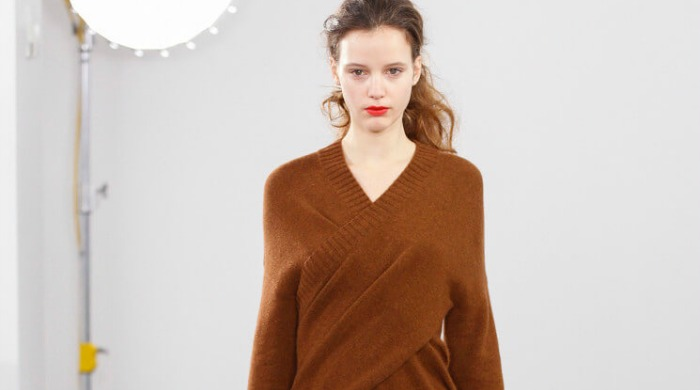 A model at London Fashion Week AW16 wearing a brown wrap jumper.