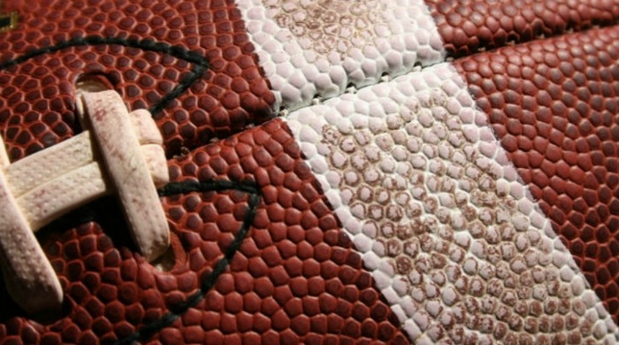 A close up of an American football.