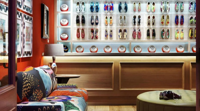 A room decorated with bowling shoes and balls in the Ham Yard Hotel, London.