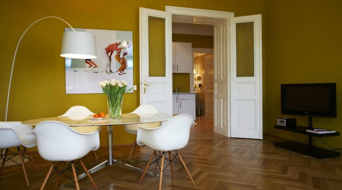 A yellow dining area in Hotel Altstadt, Vienna.
