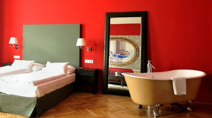 A red bedroom in Hotel Altstadt, Vienna.