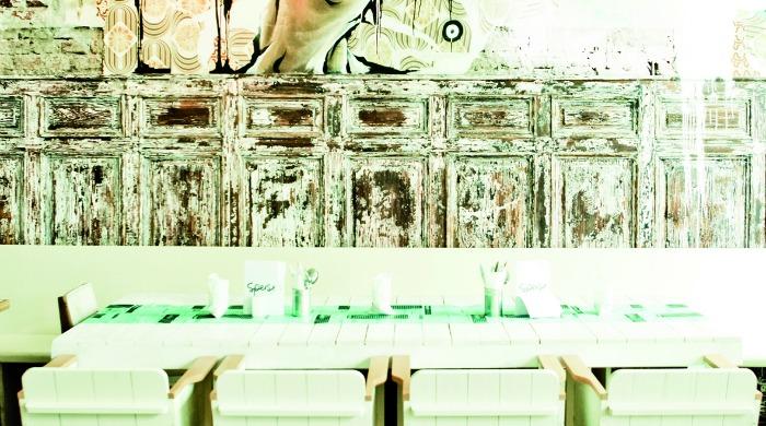 A dining area with modern art in Hotel Wiesler, Graz.