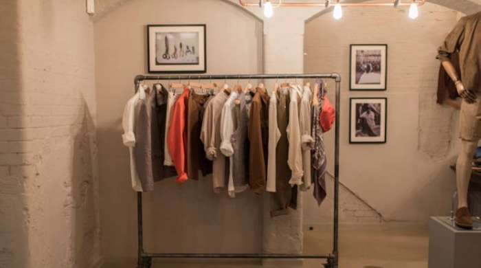 A rail filled with Private White V.C. SS16 clothing.