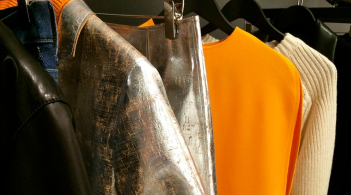 Alexander McQueen AW15 clothing hanging on a rail.