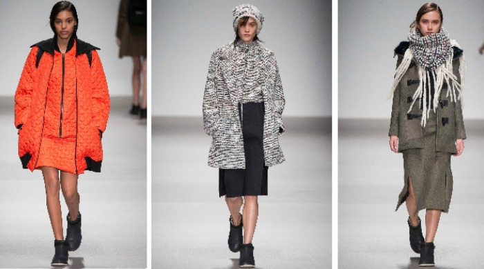 Models on the catwalk for the London Fashion Week Christopher Raeburn AW15 show.
