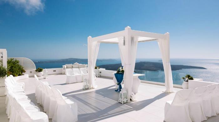 A terrace decorated for a wedding ceremony at Dana Villas, Santorini.