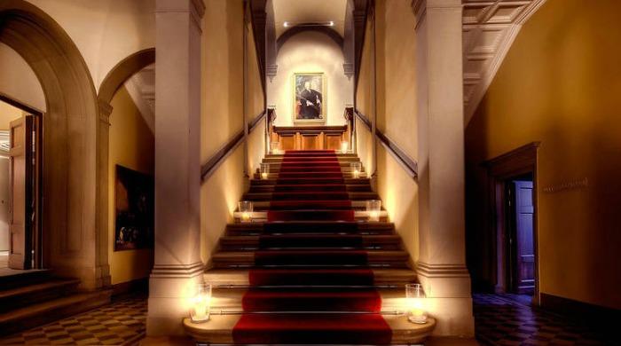 A grand corridor and staircase inside Il Salviatino, Tuscany.
