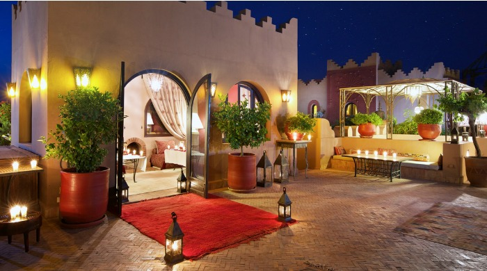 A foortop terrace decorated with candles at Kasbah Tamadot, Morocco.