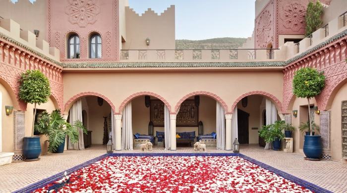 A courtyard decorated with red and white petals at Kasbah Tamadot, Morocco.