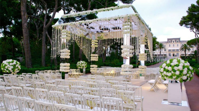 The gardens of Hotel du Cap-Eden-Roc, Antibes decorated for a wedding ceremony.