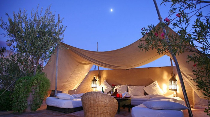 A covered outdoor seating area at Riad O2, Morocco.