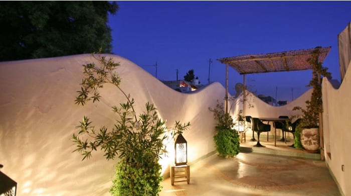 An outdoor seating area at Riad O2, Morocco.