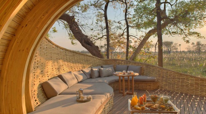 An outdoor seating area in the Sandibe Okavango Safari Lodge, Botswana.